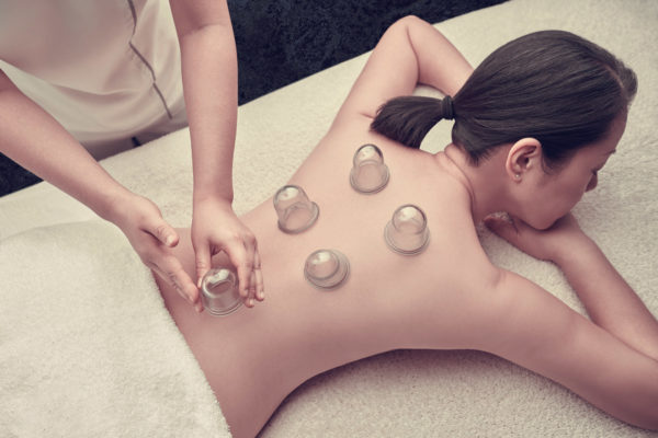 Woman receiving cupping treatment.